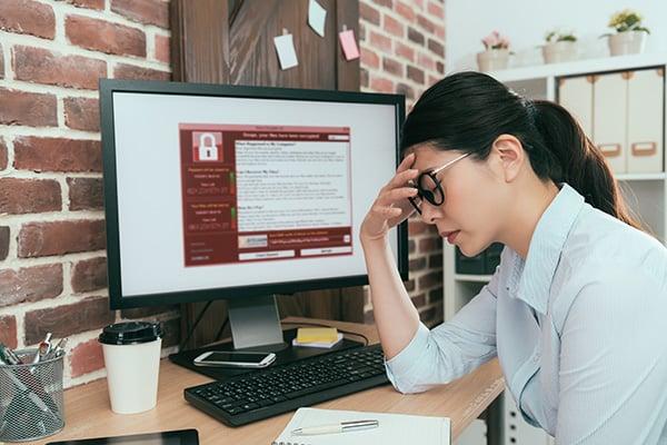 Ransomware Cyber Insurance Woman Upset